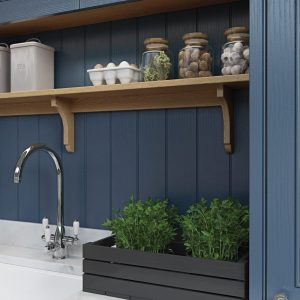 Blue painted wooden kitchen, sink with herb box | Kitchens France | cuisiniste sainte maxime