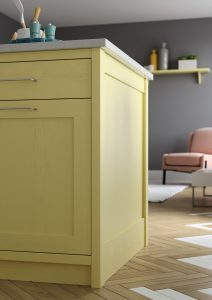 close up of yellow kitchen cabinets with geometric flooring