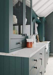 dark green dresser in kitchen with quartz worktop,kitchens france