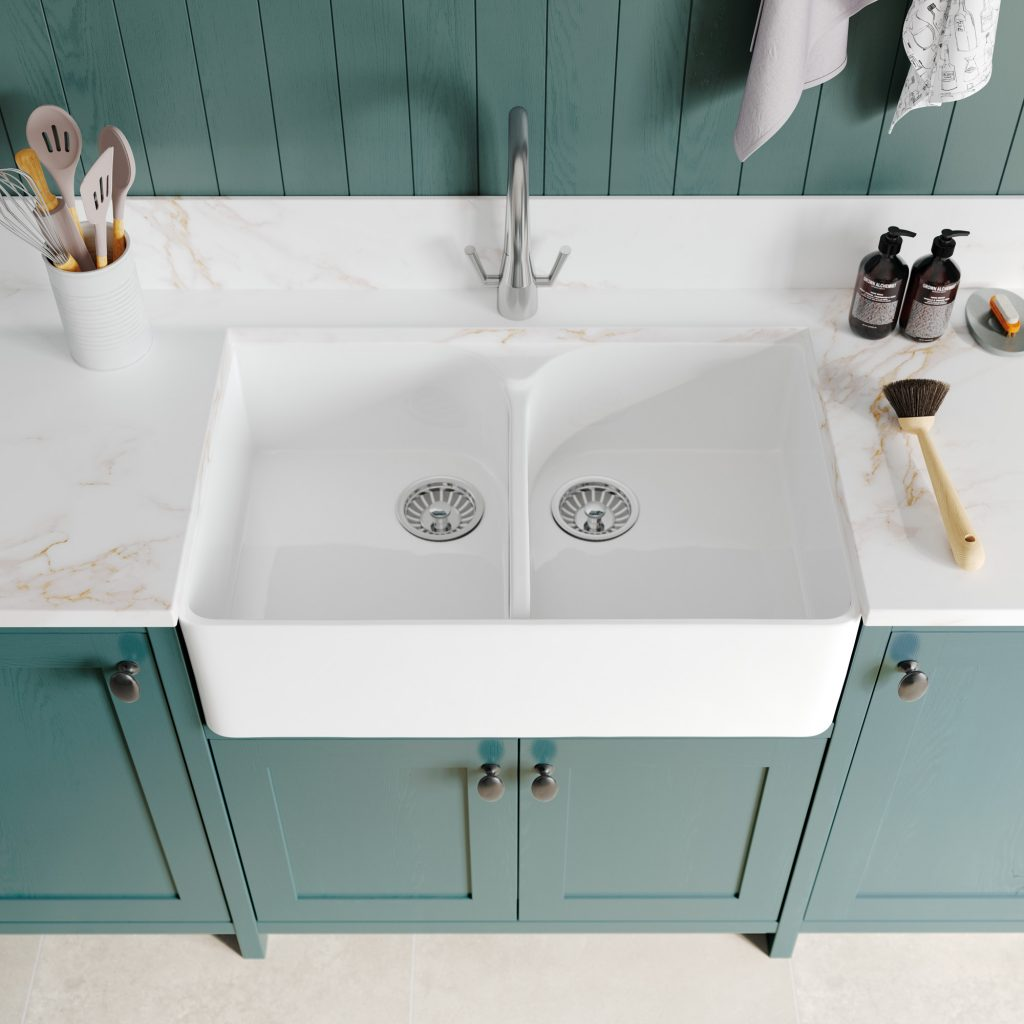 double belfast sink with quartz worktop, solid green painted kitchen cabinets, kitchens france
