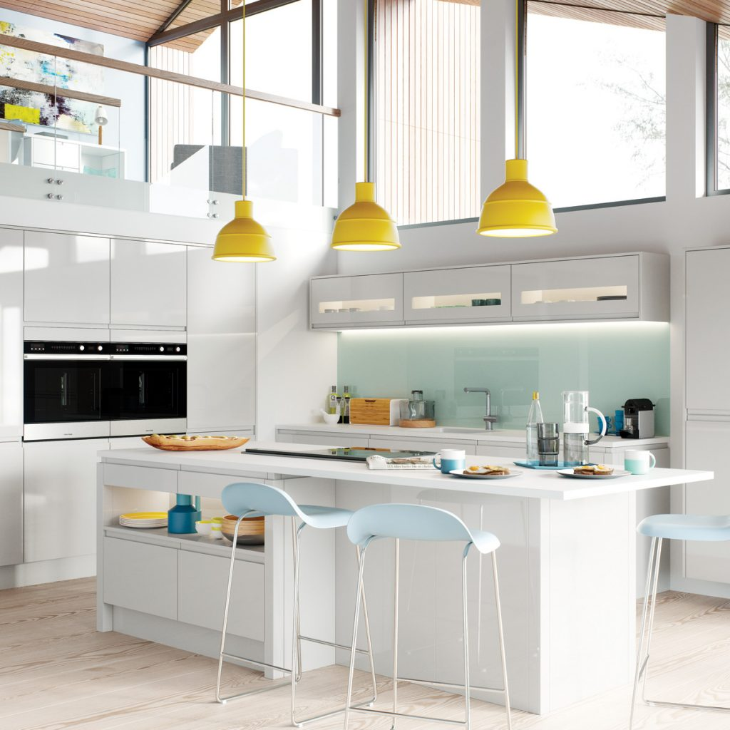 Light grey modern gloss kitchen with yellow lights and blue bar stools, modern kitchens france